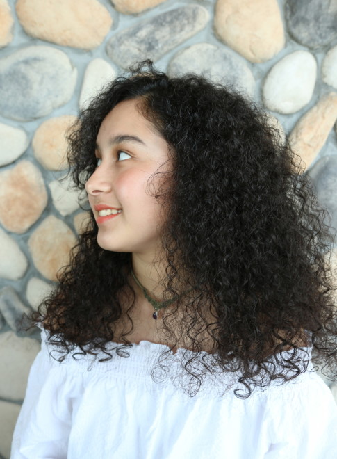 ロング ナチュラルカーリーヘア Beautrium 七里ヶ浜の髪型 ヘア